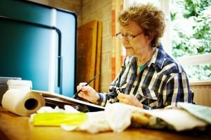 Senior woman learning to paint in an art class - a 30 days of lifestyle image